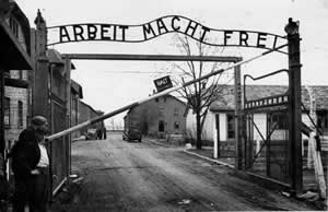 "The Holocaust - gates of the concentration camp at Auschwitz.  ""Arbeit macht frei"" is a German phrase that means ""work makes you free."""